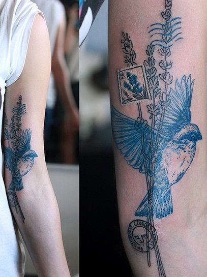 Bird and postage stamp tattoo