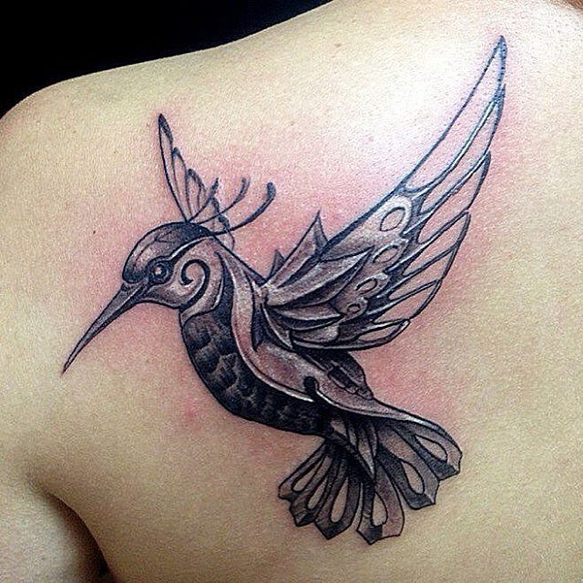 Metal bird tattoo
