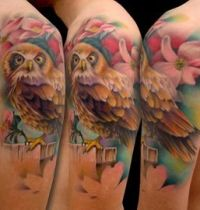 Arm tattoo with owl