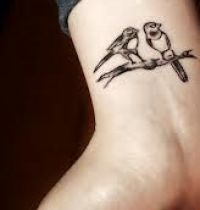 Birds couple tattoo on wrist