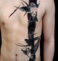 Black tattoo with birds