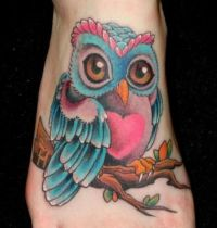 Blue and pink owl tattoo