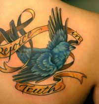 Bluebird and gold ribbon tattoo
