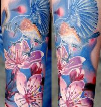 Bluebird on cherry blossom tattoo
