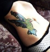 Green hummingbird tattoo