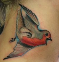 Grey and red bird tattoo