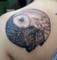 Owl symbol of the balance tattoo