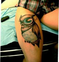 Owl with big eyes tattoo