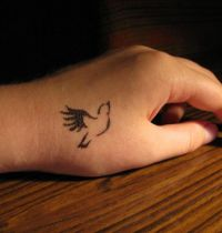 Small dove tattoo