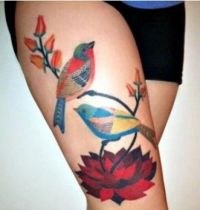 Two birds with flowers tattoo