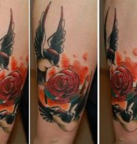 Two swallows aroun rose tattoo
