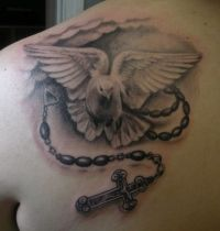 White dove with rosary tattoo