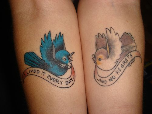 Two tattoos with birds