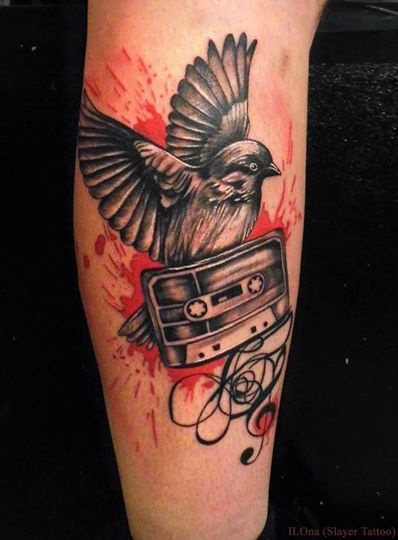 Bird and cassette tape tattoo