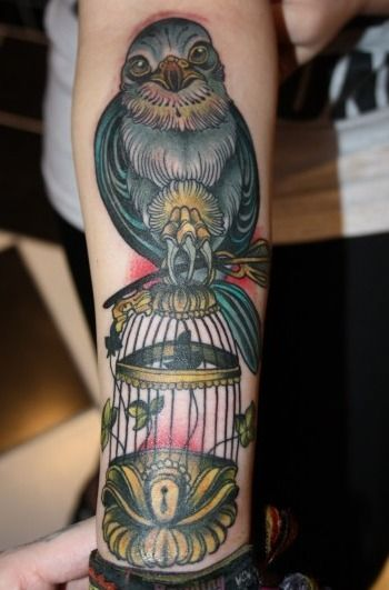 Bird on birdcage tattoo