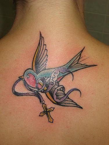 Bird with cross tattoo