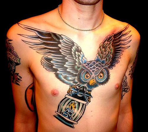 Chest tattoo with owl