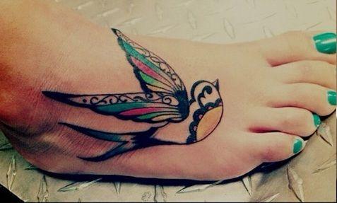Decorative swallow tattoo