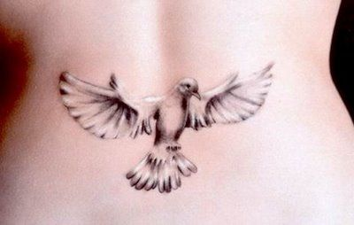 Dove with spread wings tattoo