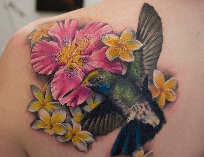 Hummingbird and hawaii flowers tattoo for Hibiscus flower tattoo shoulder blade