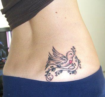Lower back small bird tattoo