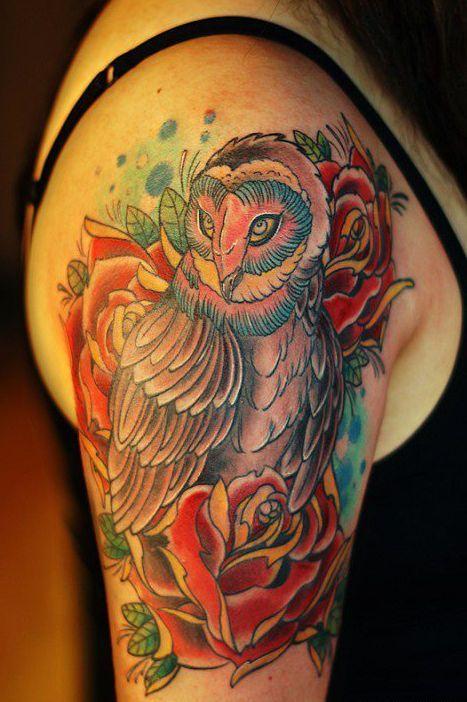 Owl among roses tattoo