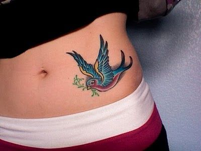 Red and blue swallow tattoo