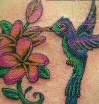 Hummingbird and flower tattoo