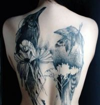Back tattoo with two birds