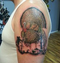 Awesome turkey and hunter tattoo