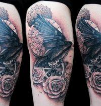 Black bird flowers and circles tattoo