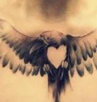Black bird with heart tattoo
