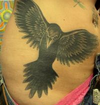 Black magpie belly tattoo