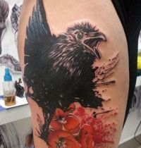 Black magpie and red poppies tattoo