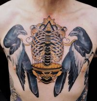 Chest tattoo with two magpies