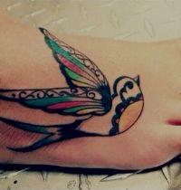Decorative bird tattoo on foot
