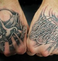 Hands tattoo with dove and words