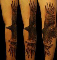 Hand tattoo with black bird
