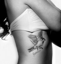 Bird and word tattoo