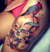 Bird on skull tattoo