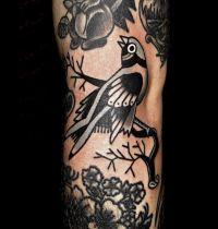 Bird tattoo folk patterns