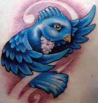 Blue bird back tattoo