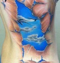 Blue sky and birds tattoo