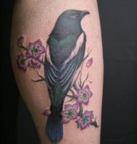 Magpie on cherry tree tattoo