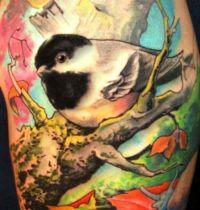 Small bird leafs tattoo