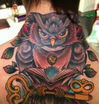Neck tattoo with owl and key