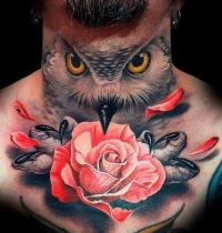 Neck tattoo with owl and rose