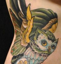 Owl with blue belly tattoo
