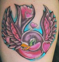 Pink bird with hearts tattoo