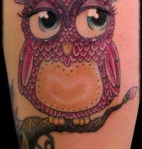 Pink owl on tree tattoo